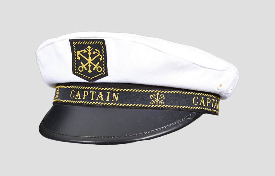 Black and white captains hat with gold lettering and anchor logos