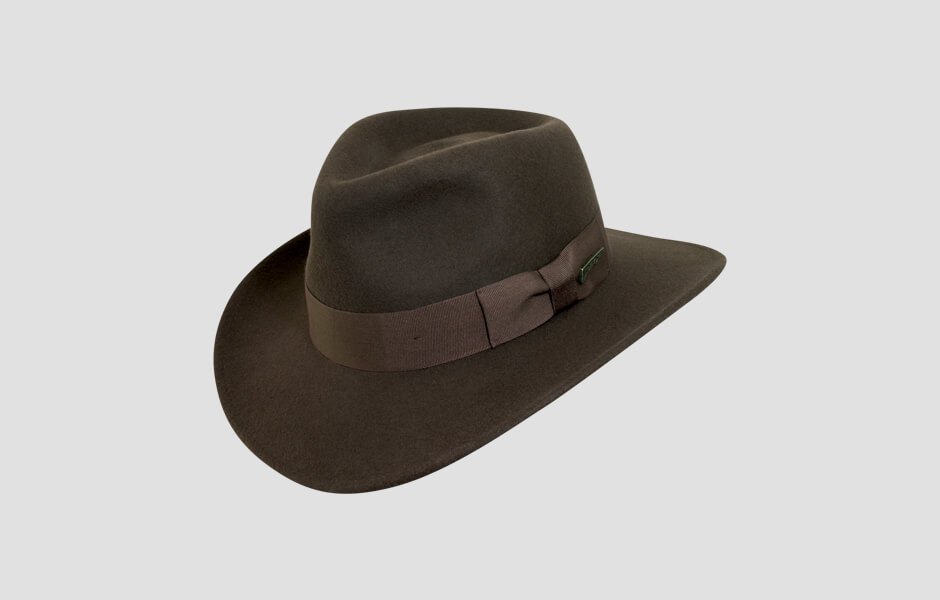 A brown Indiana Jones hat with gold pin