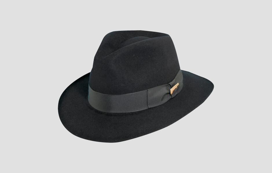 A black Indiana Jones hat with gold pin