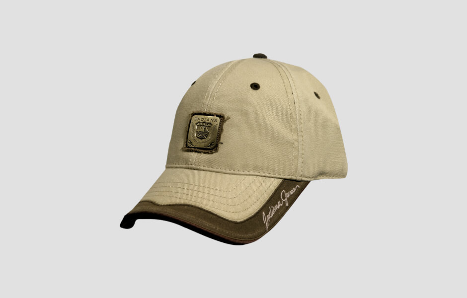 A ball cap Indiana Jones hat with front facing emblem and signature on the brim