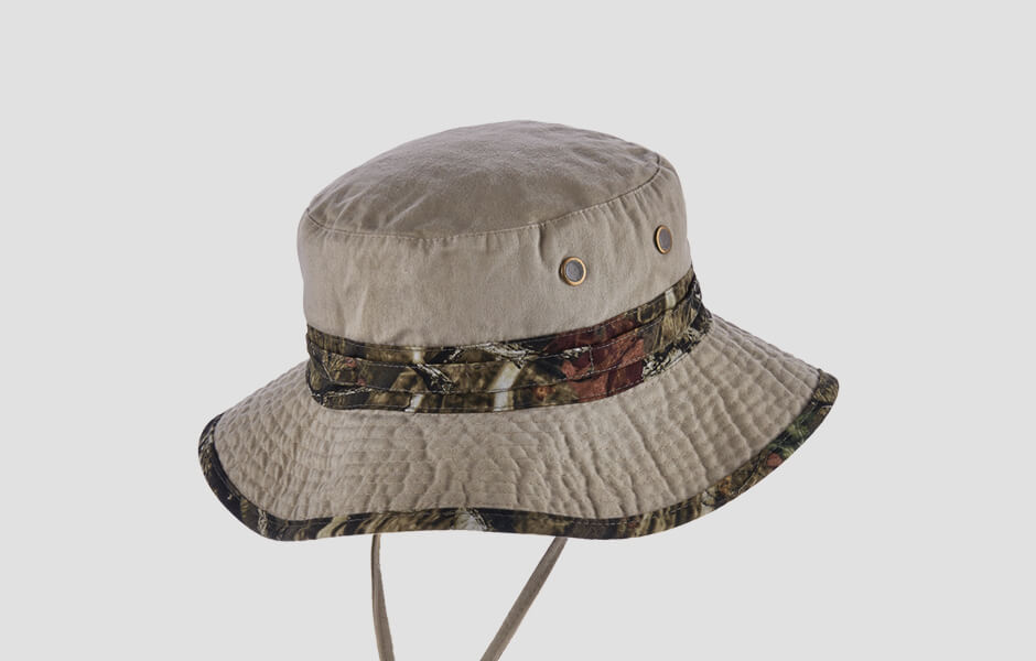 A white and camouflage colored hat with chin strap