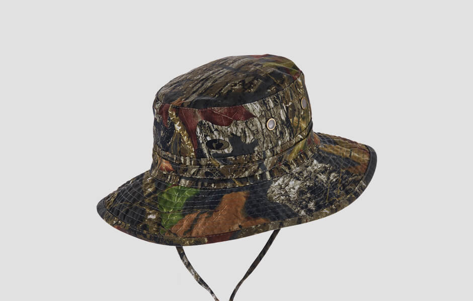 A leafy colored camouflage hat with chin strap