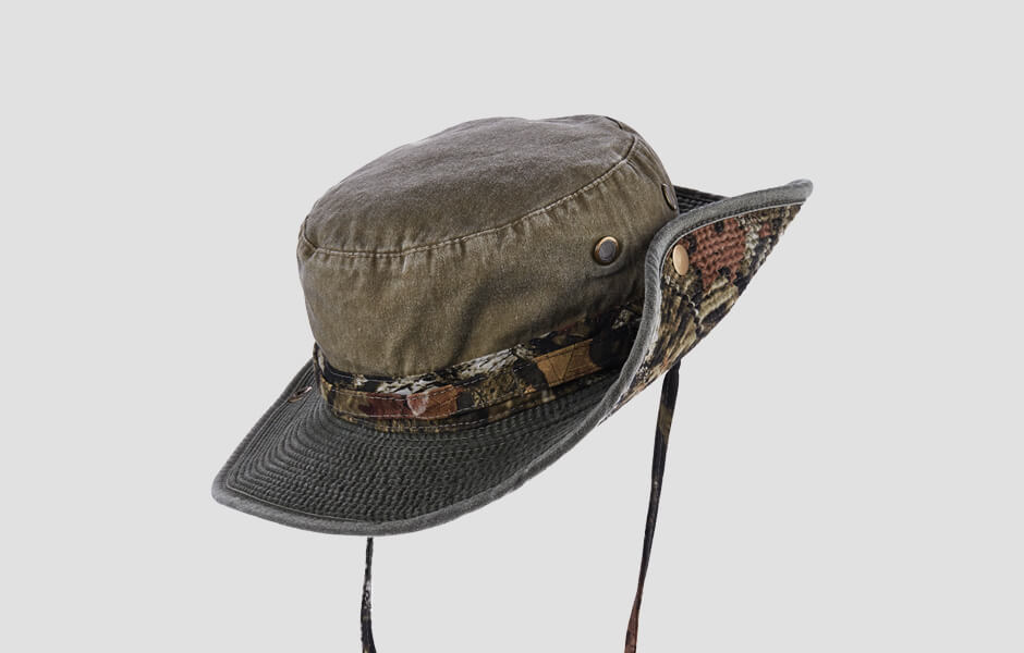 A multi-colored camouflage colored hat with chin strap