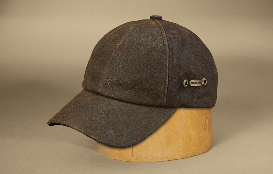 Brown ballcap hat on wood block