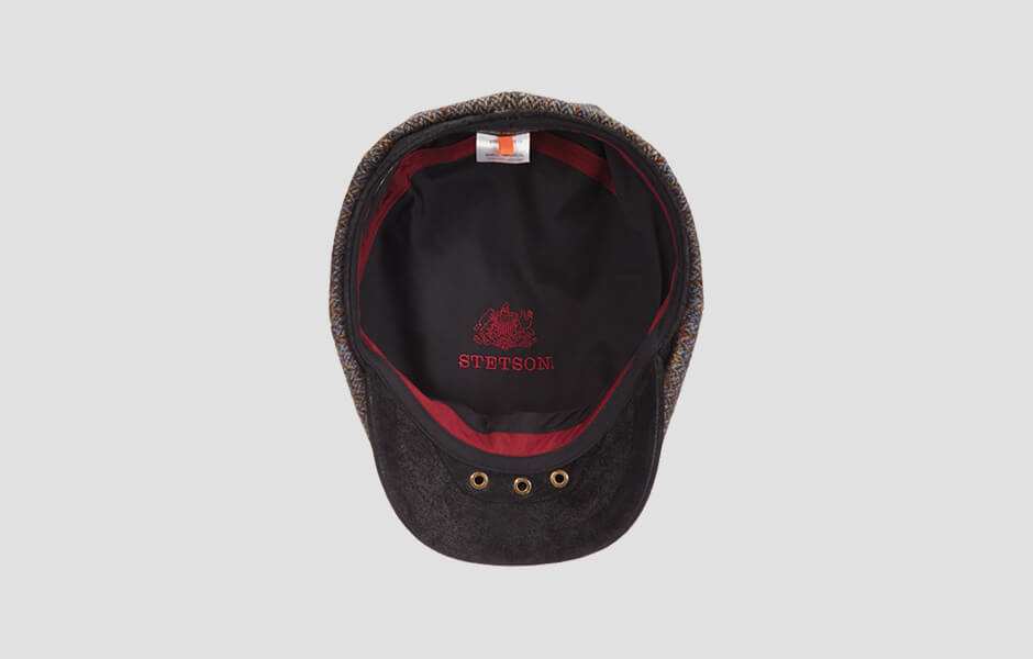 A Stetson cap from below with red lining and black interior