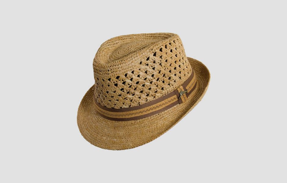 Rustic brown hat with light and brown band with swordfish pin
