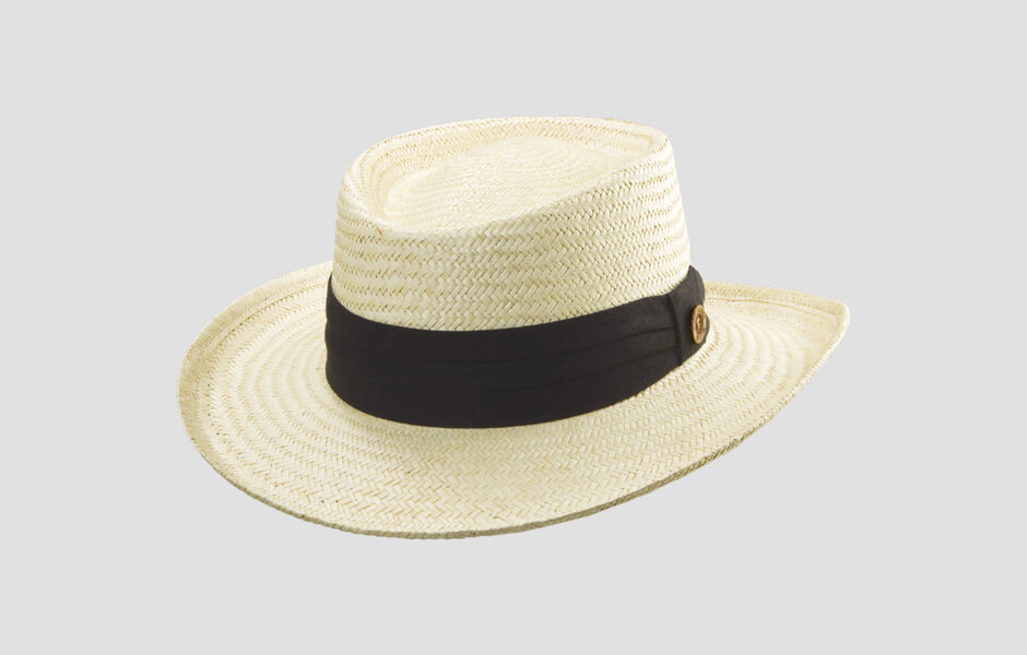 Yellowed white hat with thick black band and gold pin