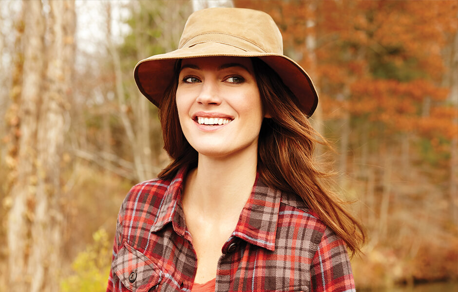 Woman wearing a hat in the forest during the day