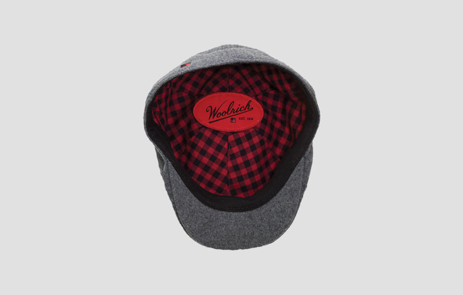 Woolrich cap with red and black plaid stitched inside