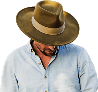 Man wearing a brown hat and white shirt with his head down